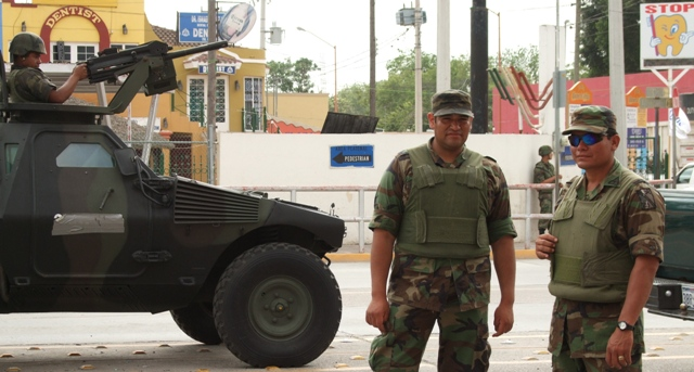 Armed guard at the Mexican-Texas border crossing