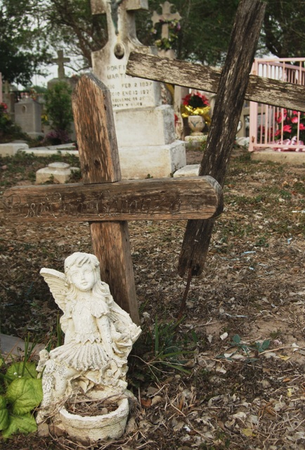 Angel on gravestone off Old Military Highway, Texasa