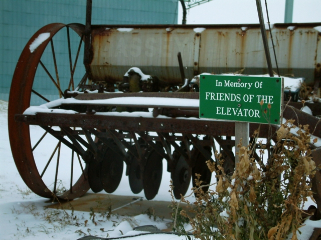 Old farm equipment near Leduc Elevator in Alberta by Sheree Zielke