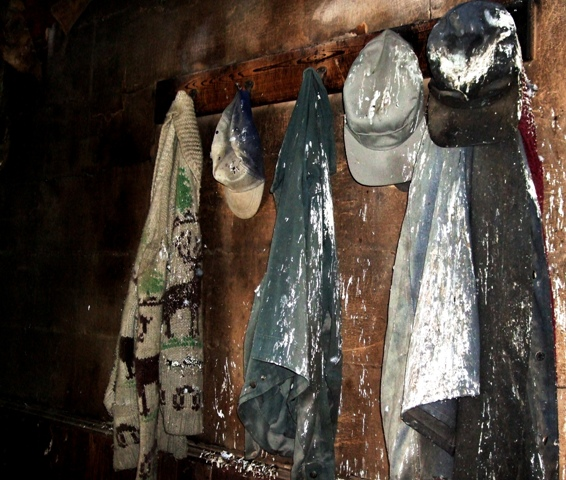 Deserted workclothes in old farm house